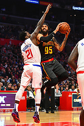 January 29, 2019 - Los Angeles, CA, U.S. - LOS ANGELES, CA - JANUARY 28: Atlanta Hawks Forward DeAndre' Bembry (95) goes up for a shot defended by Los Angeles Clippers Guard Patrick Beverley (21) during a NBA game between the Atlanta Hawks and the Los Angeles Clippers on January 28, 2019 at STAPLES Center in Los Angeles, CA. (Photo by Brian Rothmuller/Icon Sportswire) (Credit Image: © Brian Rothmuller/Icon SMI via ZUMA Press)