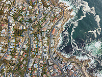 Aerial abstract view of coastal winding road and city, Bantry Bay, South Africa.
