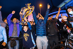 © Licensed to London News Pictures. 11/05/2021. Manchester, UK. Manchester City fans celebrate outside the Etihad Stadium after their team wins the Premiership following Manchester United's loss at home to Leicester City this evening (11th May 2021). Photo credit: Joel Goodman/LNP
