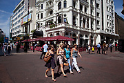Women on a day out in Leicester Square, a hugely popular area for tourism in the West End, London.