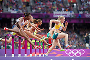 Mcc0041438 . Daily Telegraph..DT Sport..2012 Olympics..During the 100m hurdle semifinals Team GB's Tiffany Porter is passed by Australia's Sally Pearson who went on to win the Gold in the Women's 100 meter hurdle Finals ...7 August 2012....