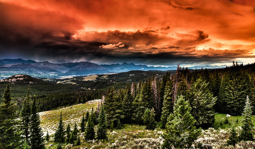 SUBJECT: Absaroka Range IMAGE: A dramatic, cloud and mountain vista of the Absaroka Range, punching 10,000 feet and more from the Beartooth Highway, one of the continent's most spectacular drives.