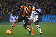 Hull City forward Adama Diomande (20)  shield the ball from Newcastle United midfielder Mohamed Diame (15)  during the EFL Quarter Final Cup match between Hull City and Newcastle United at the KCOM Stadium, Kingston upon Hull, England on 29 November 2016. Photo by Simon Davies.