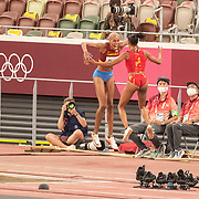 TOKYO, JAPAN August 1:   Yulimar Rojas of Venezuela is congratulated by Ana Peleteiro of Spain after breaking the world record with a leap of 15.67m during her gold medal performance in the Women's Triple Jump Final at the Olympic Stadium at the Tokyo 2020 Summer Olympic Games on August 1st, 2021 in Tokyo, Japan. (Photo by Tim Clayton/Corbis via Getty Images) CAPTION CORRECTION