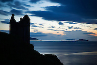Silhouetted ruin of Gylen castle on Kerrera Island, Scotland