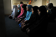 """Women and girls pray in a Denver, Colo., mosque, where three teenage girls from Aurora, Colo., who allegedly tried to connect with ISIS, attended prayer with their families. One of the mosque's imams said, """"I knew them. They went here. But that's not who we are."""""""