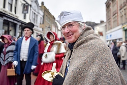 "© Licensed to London News Pictures. 03/12/2017. Rochester, UK.  A participant dressed as Scrooge from ""A Christmas Carol"" takes part in the annual Dickensian Christmas Festival in Rochester.  The Kent town is given a Victorian makeover to celebrate the life of the writer Charles Dickens (who spent much of his life there), with Victorian themed street entertainment, costumed parades and a Christmas market.  Photo credit: Stephen Chung/LNP"