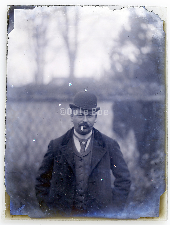 deteriorating glass plate of man with cigarette casual posing