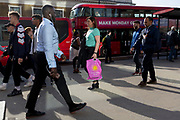 Commuters and other pedestrians walk over London Bridge, the oldest of the capital's crossing over the river Thames between the capital's financial district, the City of London, and Southwark on the south bank, on 17th May 2018, in London, UK.