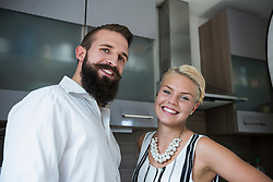 Portrait of a young couple standing in the kitchen, Bavaria, Germany