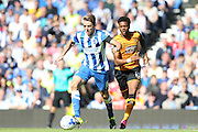 Brighton central midfielder, Dale Stephens and Hull City midfielder Sam Clucas the Sky Bet Championship match between Brighton and Hove Albion and Hull City at the American Express Community Stadium, Brighton and Hove, England on 12 September 2015.