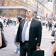 New york Business men trying to get home after a steam pipe explosion In Manhatten. The July 18, 2007 New York City steam explosion sent a geyser of hot steam up from beneath a busy intersection, with a 40 story high shower of mud and flying debris raining down on the crowded streets of Midtown Manhattan in New York City, Initial fears that the cause was terrorist related were quickly allayed by statements by mayor Michael Bloomberg and other officials shortly after the event.