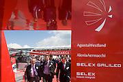 Delegates leave the Italian aerospace and defence Finmeccanica's trade stand at the Farnborough Air Show, UK.