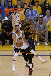 June 1, 2017 - Oakland, CA, USA - The Golden State Warriors' Stephen Curry (30) puts up a shot against the Cleveland Cavaliers' LeBron James (23) during the third quarter in Game 1 of the NBA Finals at Oracle Arena in Oakland, Calif., on Thursday, June 1, 2017. The Warriors won, 113-91. (Credit Image: © Jose Carlos Fajardo/TNS via ZUMA Wire)