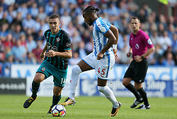 Huddersfield Town's Kasey Palmer (right) and Southampton's Oriol Romeu in action during the Premier League match at the John Smith's Stadium, Huddersfield.