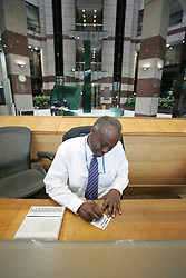 Visitor being signed in at a Croydon office building reception UK