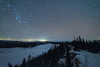 Orion shines above the High Park meadow as seen from the lookout tower on a cold January night.