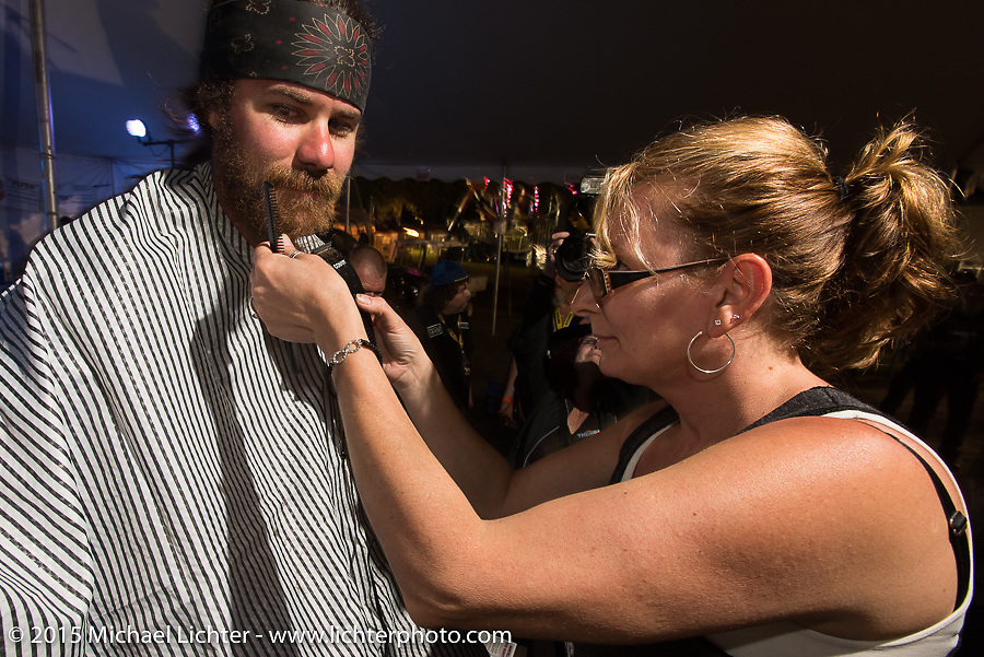 """Brad Gregory gets his beard shaved off at the Cackleberry Campground in the Chop-In Blocks """"Biker Beard-Off"""" to benefit the Aidan Jack Seeger foundation for ALD during Daytona Beach Bike Week, FL, USA. Thursday, March 12, 2015.  Photography ©2015 Michael Lichter."""