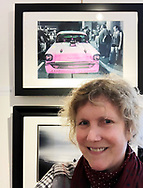 "Manhasset, New York, U.S., March 2, 2019. Ann Parry stands next to her photograph of people around a classic Chevy ""American Dream"" at Bellmore Friday Night Car Show, during Reception for The Art Guild exhibition at historic Elderfields Preserve."