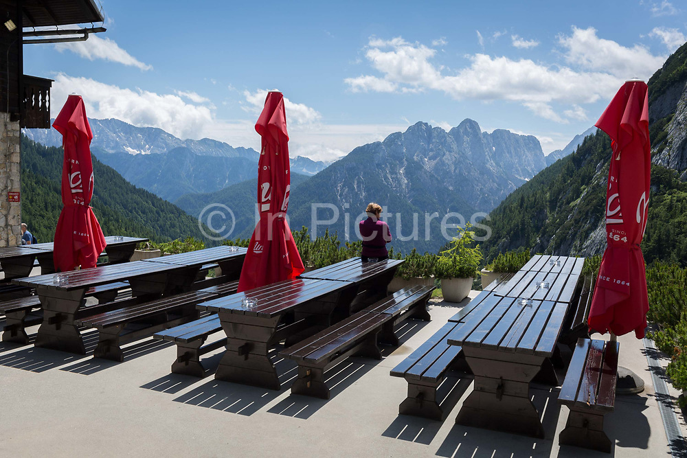 Folded sun parasols on the terrace of a cafe and restaurant with mountain views at the top of Vrsic Pass in the Slovenian Julian Alps, on 22nd June 2018, in Triglav National Park, Slovenia.