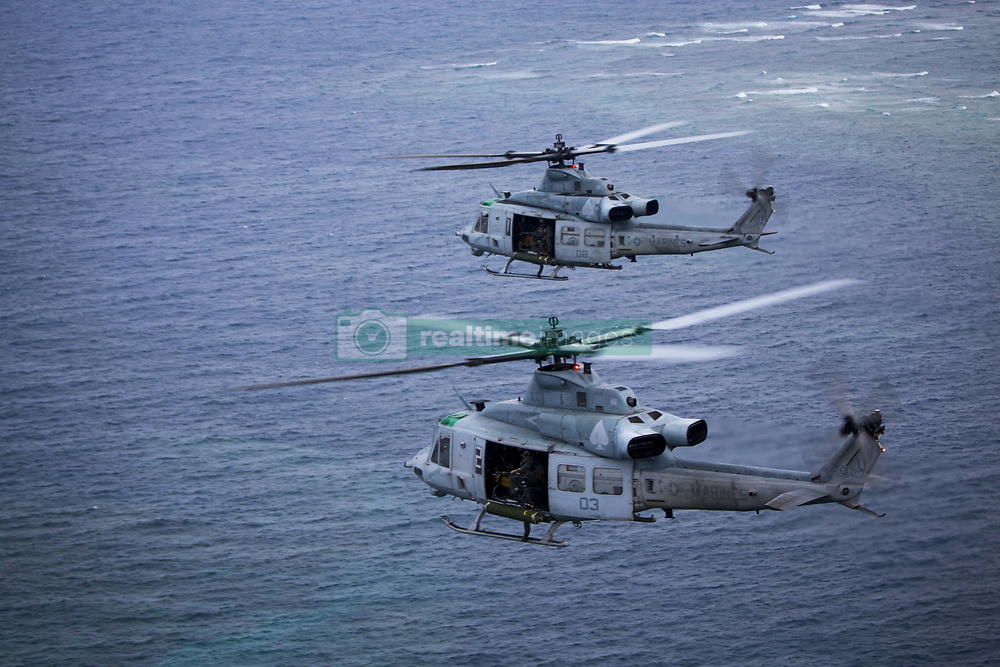 April 26, 2017 - Okinawa, Japan - Two U.S. Marine Corps UH-1Y Huey helicopters, with Marine Light Attack Helicopter Squadron- 267, fly in a formation during a Mission Rehearsal Exercise April 26, 2017 in Okinawa, Japan. U.S. Forces across the Asian region have increased combat exercises as tensions continue to rise between the U.S. and North Korea. (Credit Image: © Lcpl. Juan C. Bustos/Planet Pix via ZUMA Wire)
