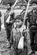 Child training with the Karen National Liberation Army. Both the government of Burma and guerrilla factions opposing the military junta use children as combatants.