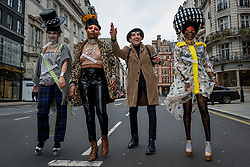 © Licensed to London News Pictures. 26/12/2020. LONDON, UK.  Designer Pierre Garroudi (2R) and models take part in a Boxing Day flashmob through St James's.  Photo credit: Stephen Chung/LNP