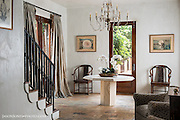 Elegant entry way with iron staircase rails and casual seating.