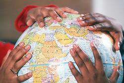 Children with globe, UK