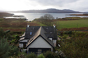 "An aerial landscape looking down to the remote Lip na Cloiche, a garden, arts shop and bed+breakfast cottage run by Lucy McKenzie, near Ulva ferry, Isle of Mull, Scotland. Beyond is Loch Tuath and the headland of the Island of Ulva. Lip na Cloiche is a small, densely-planted garden on the Isle of Mull, open to the public. Lip na Cloiche garden is beautifully situated close to the shoreline of the Isle of Mull, and has stunning views of Loch Tuath and the Isle of Ulva. A wide range of such plants is available for sale throughout the year, as well as fresh eggs and many craft items made from locally ""found"" materials. There is no admission charge. http://www.lipnacloiche.co.uk"