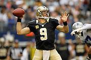 New Orleans Saints quarterback Drew Brees (9) throws a pass down the field against the Dallas Cowboys at Cowboys Stadium in Arlington, Texas, on December 23, 2012.  (Stan Olszewski/The Dallas Morning News)