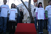 Activists of Movement for Self-Determination and the flag-stone of two Martyrs