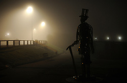 © Licensed to London News Pictures. 20/11/2011..Saltburn, England...The statue of Henry Pease, the founder of Saltburn, stands shrouded in fog in the early evening...Photo credit : Ian Forsyth/LNP