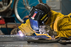 Billy Lane of Chopper's Inc welds another gas tank for Saturday's Sons of Speed Race of nearly century old boardtrack style bikes at New Smyrna Speeday during Daytona Beach Bike Week. FL. USA. Tuesday, March 14, 2017. Photography ©2017 Michael Lichter.