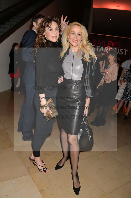 Left to right, MARIE HELVIN and JERRY HALL at a private view of photographs by David Bailey entitled 'Bailey's Stardust' at the National Portrait Gallery, St.Martin's Place, London on 3rd February 2014.
