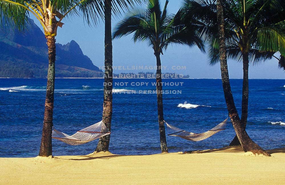 Image of twin hammocks under palm trees by ocean waterfront at Princeville Resort, Hanalei Bay overlooking Bali Hai, Kauai, Hawaii by Randy Wells