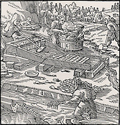Washing for gold by laying pieces of turf in a frame.  Gold-bearing sand is placed in head of the frame at A, water is then allowed to wash over it.  Gold collected on the turf at C.  The pieces of turf then washed individually at E and the gold recovered. From 'De re metallica', by Agricola, pseudonym of Georg Bauer (Basle, 1556).  Woodcut.