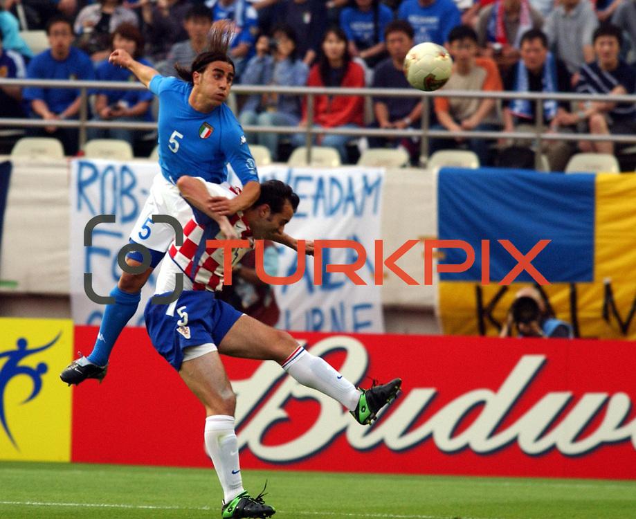 Italy's Fabio Cannavaro outjumps Croatia's Milan Rapaic