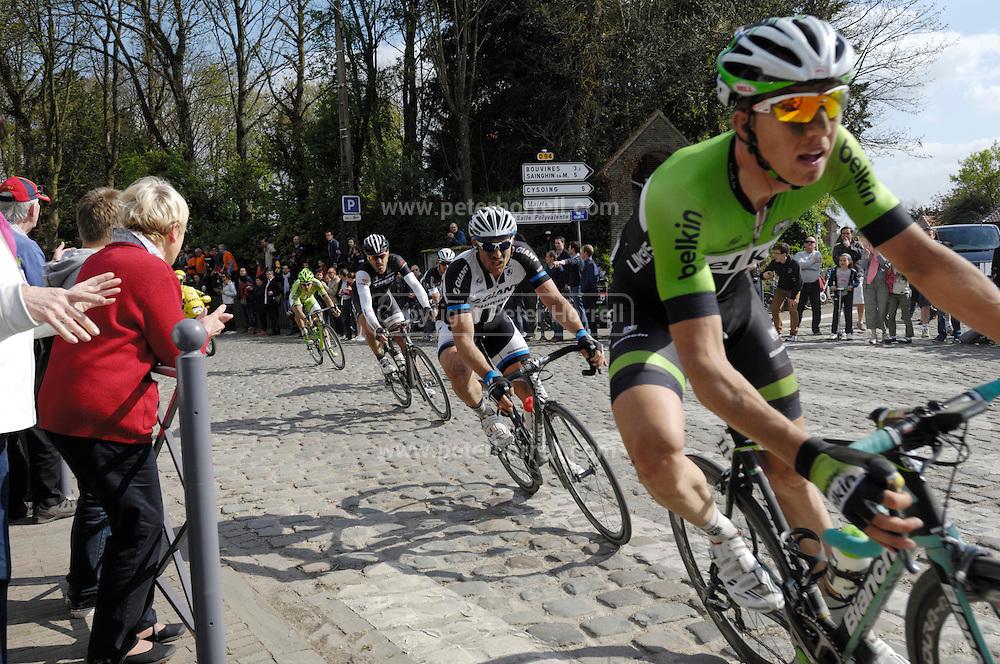 France April 13th 2014: Sep Vanmarcke, Belkin, is followed by John Degenkolb, Team Giant Shimano, Fabian Cancellara, Trek, and Peter Sagan, Cannondale, through Gruson on the way to the finish in Roubaix Velodrome. Copyright 2014 Peter Horrell