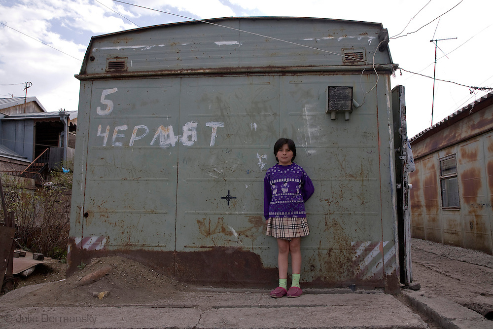 girl in front of the container she lives in Gyumri Armenina