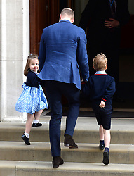 The Duke of Cambridge with Princess Charlotte and Prince George enter the Lindo Wing at St Mary's Hospital in Paddington, London. Photo credit should read: Doug Peters/EMPICS Entertainment