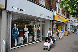 © London News Pictures. 14/07/2013. COPY AVAILABLE BELOW…. Save The Children charity shop on Orpington High Street, Kent. Orpington High street now has 12 charity shops  in one short stretch, with Cancer Research UK having two shops on different sides of the high street almost facing each other.  COPY AVAILABLE HERE:  http://tinyurl.com/nhtxtyd<br /> <br /> Photo credit :Grant Falvey/LNP