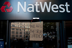 © Licensed to London News Pictures. 15/10/2011. LONDON, UK. A branch of Natwest has a sign placed over the doors by protesters occupying the square in front of St Paul's Cathedral.  Protesters attempted to occupy the London Stock Exchange today (Saturday) in solidarity with protests in New York's financial district but were stopped by Police. Photo credit : James Gourley/LNP
