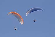 Ellenville, NY - Two paragliders soar in the sky above Ellenville on May 30, 2009.