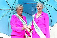 Two of the York Pink Lady Team ( Julie & Froot ) shelter from the rain prior to the Countryside Raceday, October Finale at York Racecourse, York, United Kingdom on 12 October 2018. Pic Mick Atkins