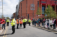 Football - 2019 / 2020 Premier League - Liverpool vs Aston Villa<br /> <br /> A handful of fans wait for the Liverpool team bus to arrive , at Anfield.<br /> <br /> COLORSPORT/TERRY DONNELLY