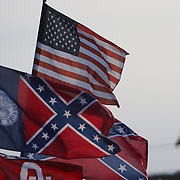 A Confederate flag flies in the infield during the 57th Annual NASCAR Coke Zero 400 practice session at Daytona International Speedway on Friday, July 3, 2015 in Daytona Beach, Florida.  (AP Photo/Alex Menendez)