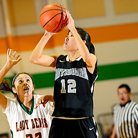 011014  Adron Gardner/Independent<br /> <br /> Miyamura Patriot Presleigh Smiley (12), right, shoots over Wingate Bear Shyler Lowley (32) in Wingate Friday.