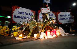Flowers and candles are seen at a makeshift memorial remembering the victims of a shooting on Sunday evening on Danforth, Ave. in Toronto, ON, Canada, on Monday, July 23, 2018. Photo by Mark Blinch/CP/ABACAPRESS.COM