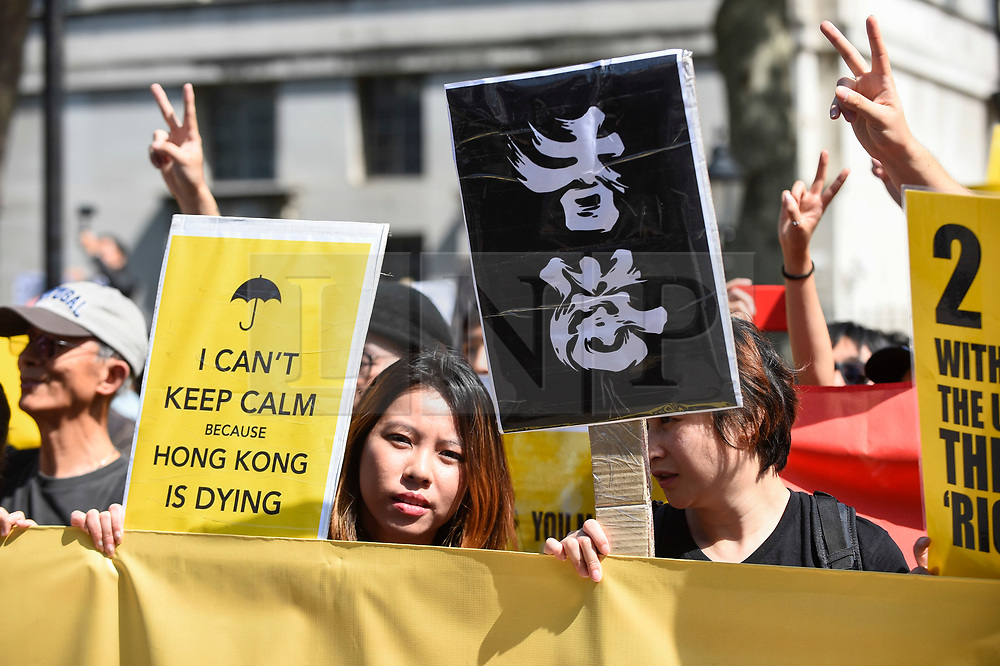 """© Licensed to London News Pictures. 17/08/2019. LONDON, UK.  Demonstrators outside Downing Street take part in a rally to show solidarity with the people of Hong Kong.  Similar """"Global Solidarity with Hong Kong"""" rallies are taking place worldwide as protests in the former British colony enter their tenth week demanding democratic reforms and a halt to police brutality.  Photo credit: Stephen Chung/LNP"""